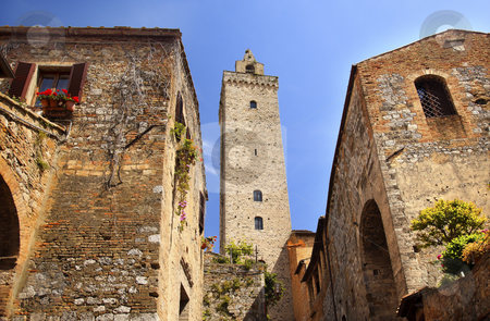 Medieval Stone Cuganensi Tower Ancient Buildings San Gimignano T stock photo, Medieval Stone Cuganensi Tower Ancient Buildings Town San Gimignano Tuscany Italy by William Perry