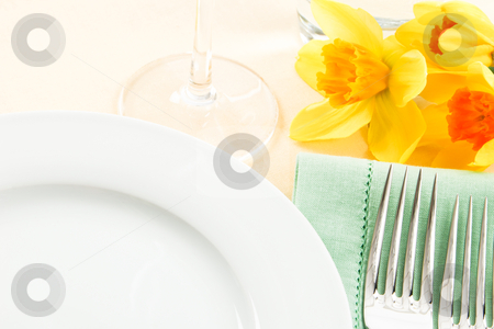 Fresh Yellow Table Setting stock photo, A pretty table setting in white, green and yellow has ample copy space for Spring and Mother's Day promotions by Karen Sarraga