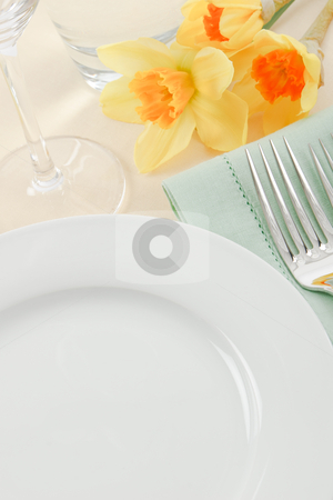 Spring Table Setting stock photo, A pretty table setting in white, green and yellow has ample copy space for Spring and Mother's Day promotions by Karen Sarraga