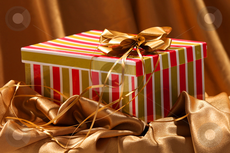 Christmas gift box stock photo, christmas gift box with a golden bow by vladacanon1