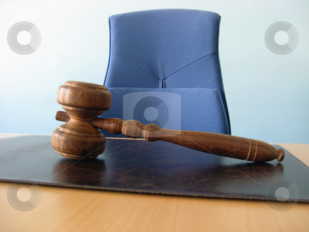 The court desk stock photo, Old wooden gavel, a blue chair and a court desk by Ingvar Bjork