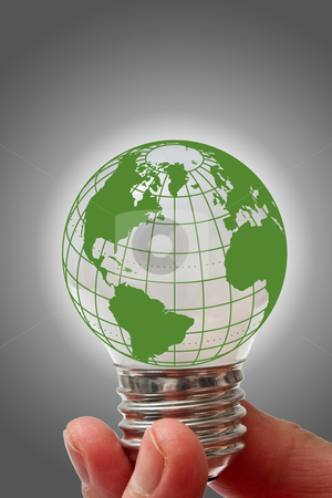 Light bulb with globe  stock photo, Light bulb with globe hold in hand by Ingvar Bjork
