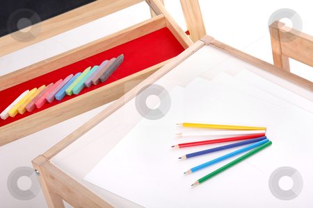 Objects in kindergarten stock photo, details of blackboard with chalks and desk with pencils in kindergarten by vladacanon1