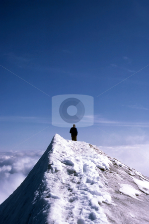 A man standing on the top of snow mountain stock photo, A man standing on the top of snow mountain by Ingvar Bjork