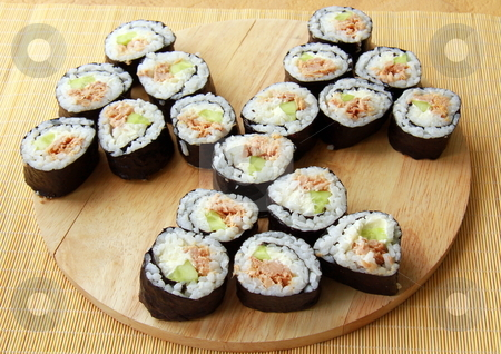Traditional Japanese food maki rolls on a wooden board stock photo, Traditional Japanese food maki rolls on a wooden board by Olga Kriger