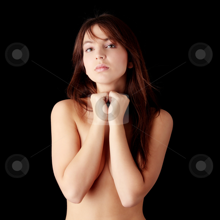 Nude female stock photo, Nude female, covering her body with hands, isolated on black