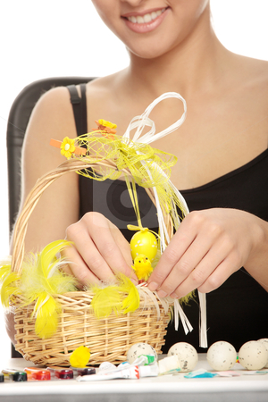 Easter decorations stock photo, Young caucasian woman making easter decorations, over white background by Piotr_Marcinski