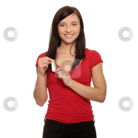 Smiling woman holding a pregnancy test stock photo, Smiling woman holding a pregnancy test, isolated on white by Piotr_Marcinski