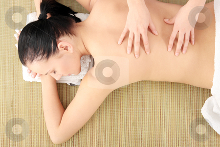Woman having massage stock photo, Beautiful young woman having massage by Piotr_Marcinski