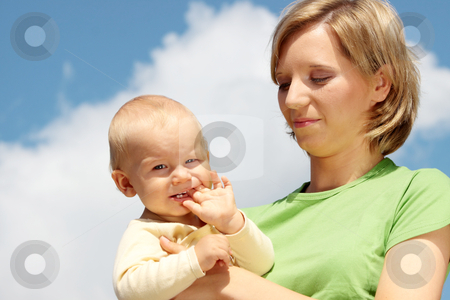 Mother with baby under blue sky stock photo, Mother with baby under blue clear sky by Piotr_Marcinski
