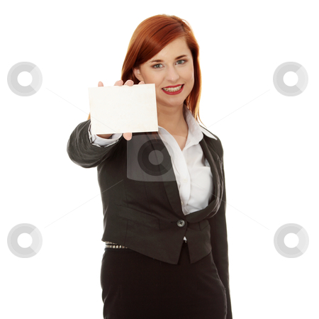 Business woman holding a blank card stock photo, Beautiful smiling business woman holding a blank card over a white background - focus on card by Piotr_Marcinski