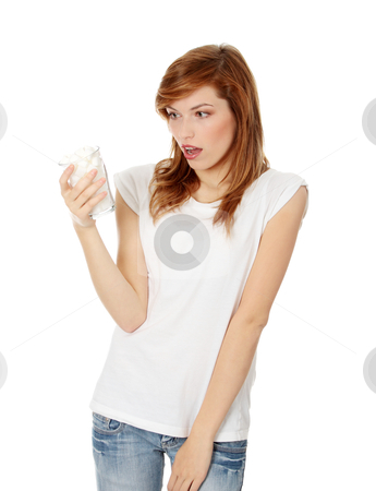 Young surprised woman with lot of cugar in glass stock photo, Young shocked woman with lot of cugar in glass. Lot of callories in drink by Piotr_Marcinski
