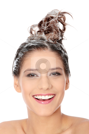 Haircare stock photo, Beautiful young brunette woman with attractive smile soaping her head - isolated on white background  by Piotr_Marcinski