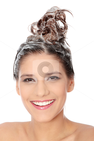 Beautiful brunette woman soaping her head stock photo, Beautiful young brunette woman with attractive smile soaping her head - isolated on white background  by Piotr_Marcinski