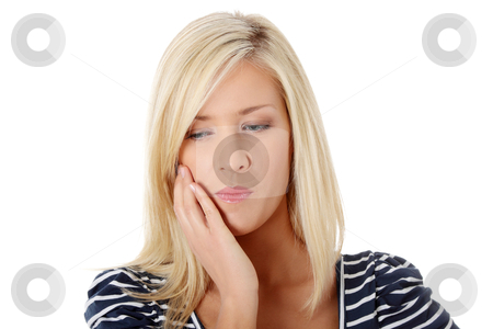 Young woman in pain stock photo, Young woman in pain is having toothache isolated on white by Piotr_Marcinski