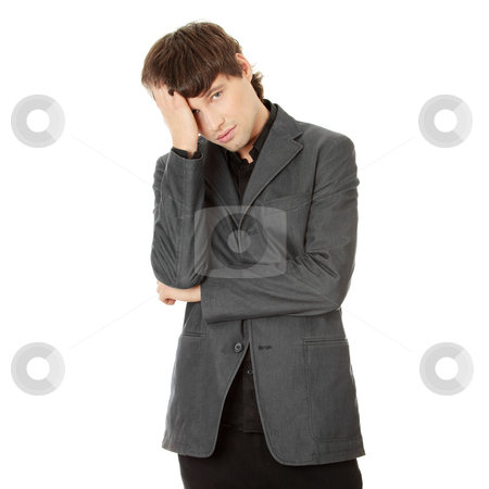 Headache or problem stock photo, Young businessman with a big headache or problem, isolated on white by Piotr_Marcinski