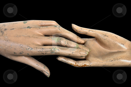 Join hands stock photo, Weathered hands of plastic mannequin doll. by sirylok