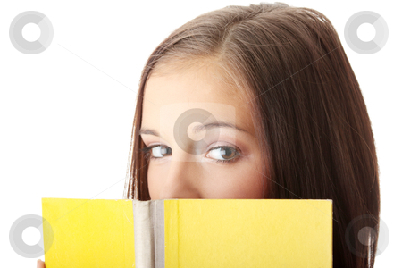 Young caucasian woman reading stock photo, Young caucasian woman reading a book isolated on white background by Piotr_Marcinski
