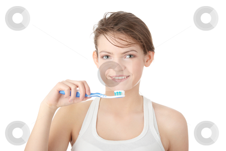 Young girl brushing her teeth happily stock photo, Young girl brushing her teeth happily, isolated  by Piotr_Marcinski