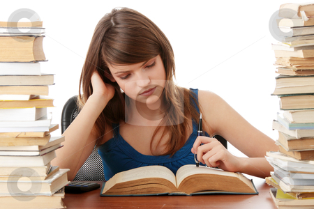 Teen girl learning stock photo, Teen girl learning at the desk with lot of books, isolated on white by Piotr_Marcinski