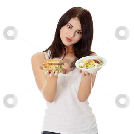 Helthy or not stock photo, Beautiful caucasian woman thinking whot to eat: hamburger or salat. Isolated on white by Piotr_Marcinski