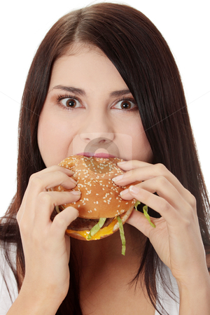 Woman eating hamburger stock photo, Beautiful caucasian woman eating hamburger. Isolated on white by Piotr_Marcinski