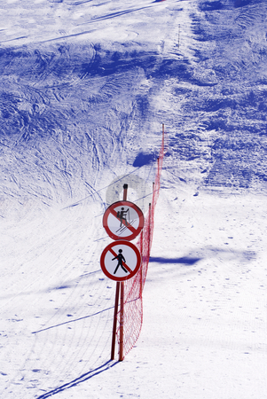 Skiers stock photo, skiers on ski slope with a snowboard  by freeteo