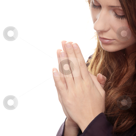 Young caucasian woman praying stock photo, Closeup portrait of a young caucasian woman praying by Piotr_Marcinski