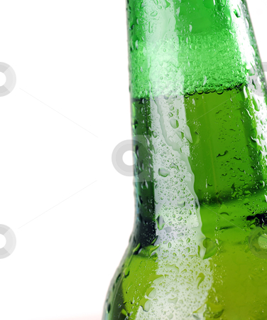 Beer bottle stock photo, Green beer bottle with water drops on white  by sutike