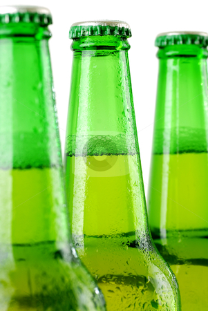 Beer bottles stock photo, Three beer bottles with water drops on white  by sutike