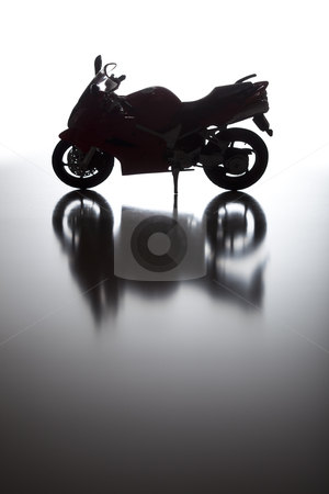 Silhouette of Street Motorcycle on Reflective Surface  stock photo, Silhouette of Street Motorcycle on Reflective Surface Against a White Background. by Andy Dean