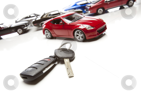 Car Keys and Several Sports Cars on White stock photo, Car Keys and Several Sports Cars on White Background. by Andy Dean