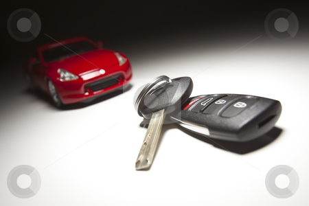 Car Keys and Sports Car stock photo, Car Keys and Sports Car Under Spot Light. by Andy Dean