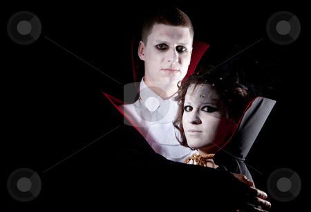 Vampire couple portrait stock photo, a young vampire couple posing together black background by Jerax