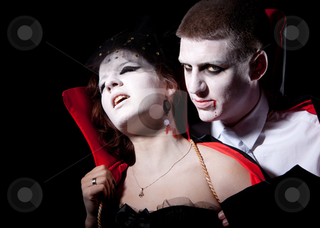 Vampire couple bite stock photo, a vampire biting a young woman from behind by Jerax