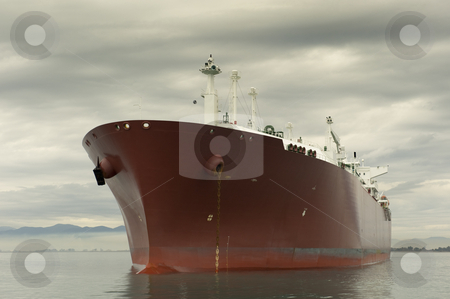 Liquefied gas carrier ship stock photo, Large red liquefied gas carrier ship anchored near the shore by Andreas Karelias