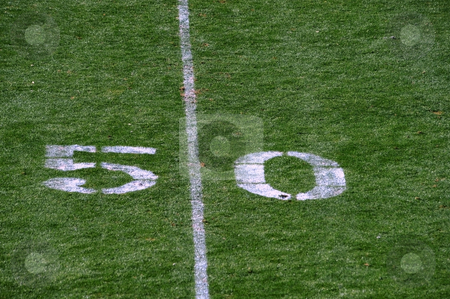 Fifty yard line. stock photo, Fifty yard line at a football  by WScott