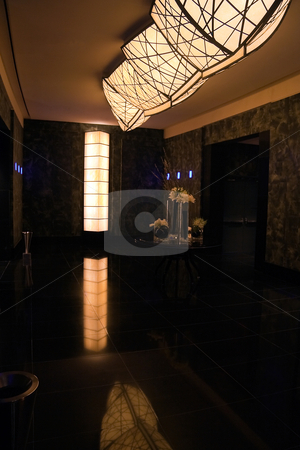 Hotel Lobby stock photo, An empty modern hotel lobby with a deep green granite by Kevin Tietz