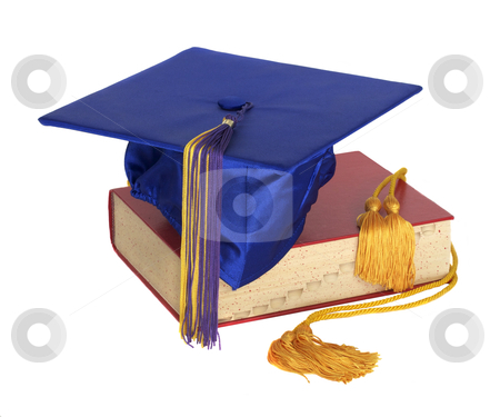 Graduation Hat and Honor Cord stock photo, A graduation hat and honor cord on top of a text book by David Schliepp