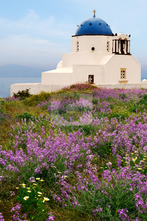 Countryside chapel in Santorini, Greece stock photo, Picture of a small chapel on the beautiful island of Santorini, near a spring flower bed.  by Andreas Karelias