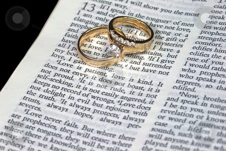 Love is Patient Bible Verse with Rings stock photo, Macro of 1 Corinthians 13:4 Love is Patient with Wedding Bands by David Schliepp