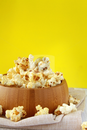 Classic popcorn  in a wooden cup  stock photo, classic popcorn  in a wooden cup  by Olga Kriger