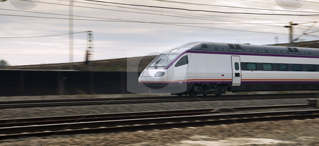 High speed train stock photo, High speed train in blurry motion near Cordoba Station in Spain by paulrommer
