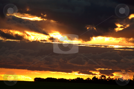 Colorful clouds during a Saskatchewan sunset stock photo, Colorful clouds during a Saskatchewan sunset by Mark Duffy