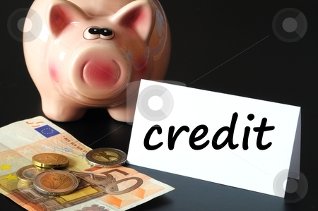 Credit stock photo, financial credit concept with piggy bank and money on black by Gunnar Pippel