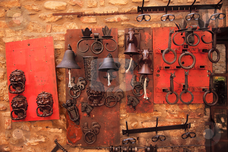 Brass Door Knockers Bells Medieval Town San Gimignano Tuscany Italy stock photo, Brass Door Knockers Bells Medieval Stone Town San Gimignano Tuscany Italy by William Perry