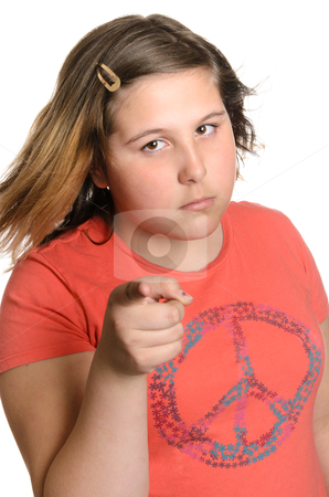 Discipline stock photo, A young preteen girl giving the viewer heck or discipline for something, isolated against a white background. by Richard Nelson