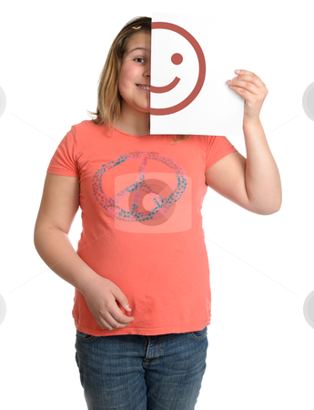 Happy stock photo, A happy smiling girl is holding up a white piece of paper with half a happy face on it. by Richard Nelson