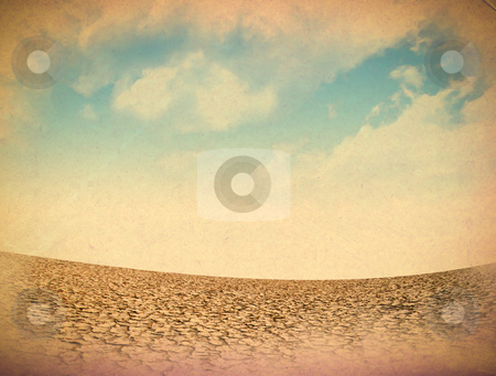 Dried and cracked soil in blue sky  stock photo, Dried and cracked soil in blue sky by rufous