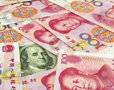 US Dollar in Trouble stock photo, US Hundred dollar bill surrounded by Chinese Yuan  by tab62